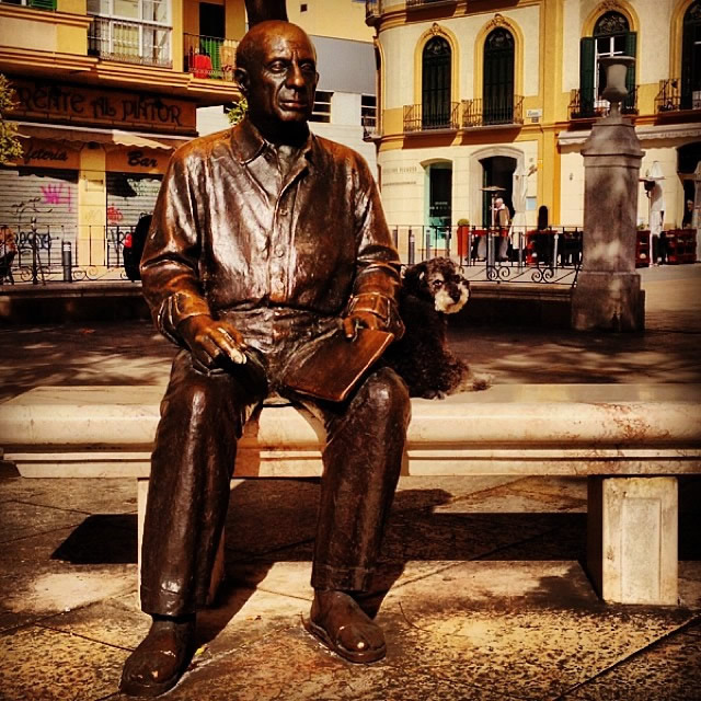 Willie sits with Pablo Picasso at Plaza De la Merced in Malaga Spain
