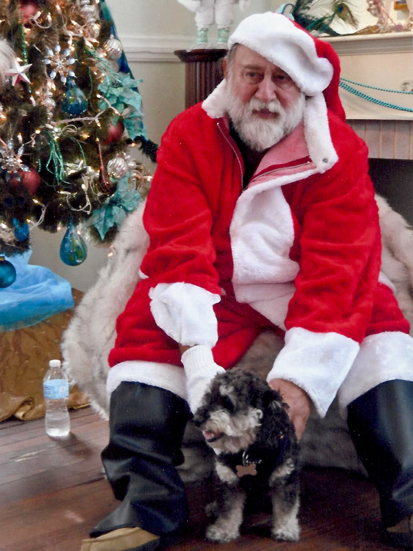 Willie poses with hangover Santa in Melrose Florida