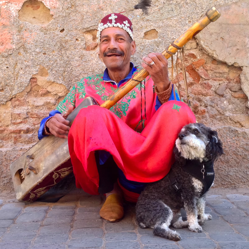 Willie poses with a Street musician in Marrakesh Morocco