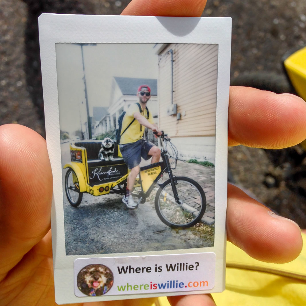 Willie takes a polaroid photo with his friend Nick in the Bywater