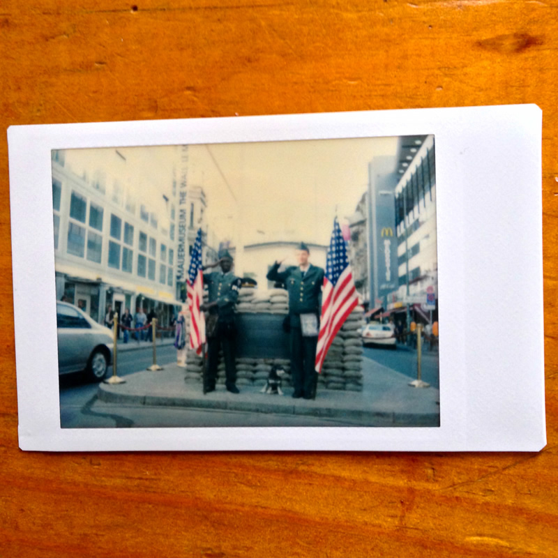 Polaroid of Willie at Checkpoint Charlie in Berlin Germany