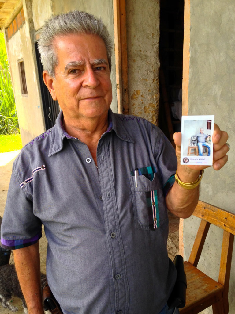 Alee's grandfather shows his polaroid with Willie