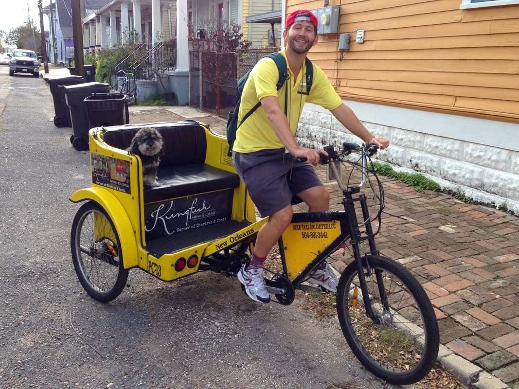 Willie grabs a ride on Nick's bike taxi in New Orleans