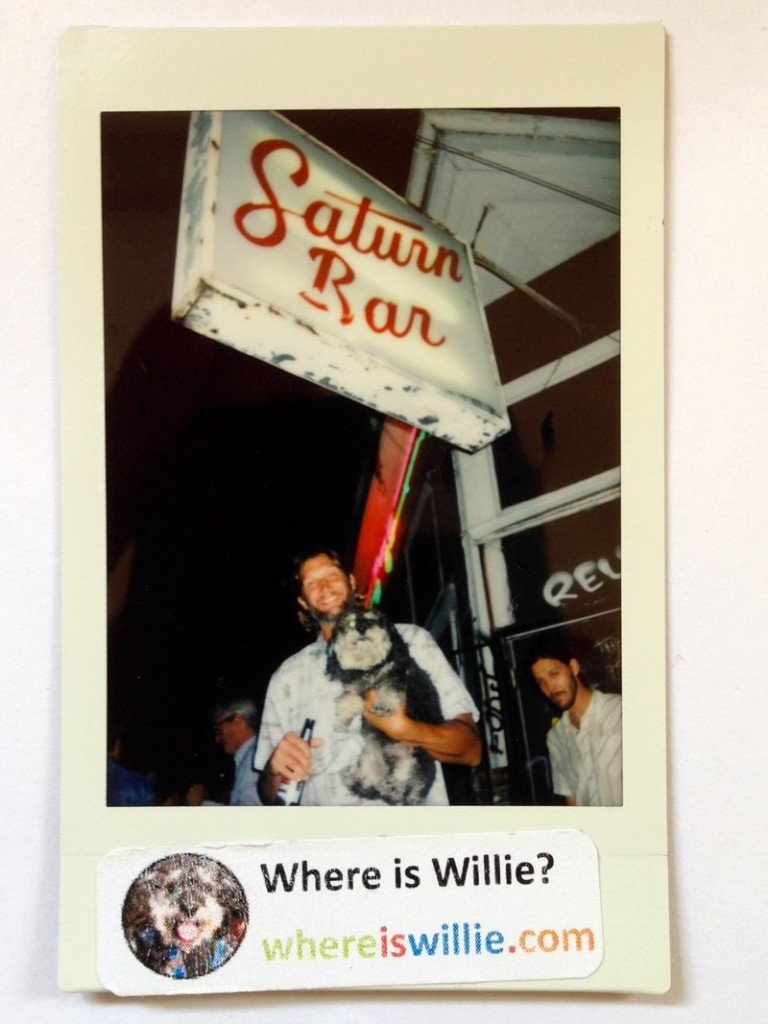 Willie takes a polaroid photo with Adam outside the Saturn Bar in the Bywater New Orleans