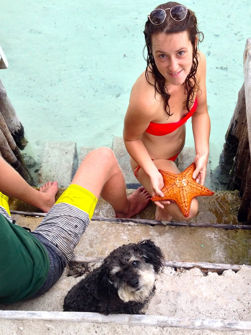 Willie with Michelle and a starfish on Bread & Butter Caye Belize