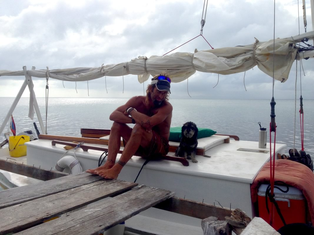 Willie with the Captain on Bread & Butter Caye Belize