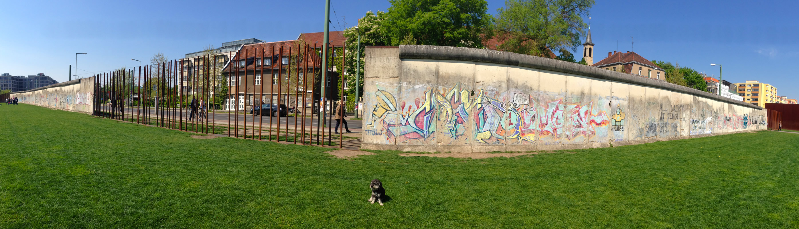 Willie sits in front of a Wall memorial on Bernauer Strasse in Berlin Germany