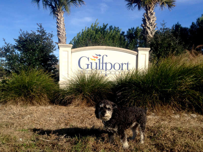 Willie at the welcome sign in Gulfport Mississippi