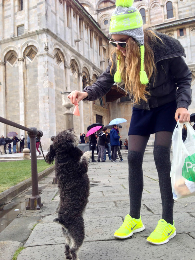 Willie gets a snack from a new friend at the Leaning Tower of Pisa in Italy