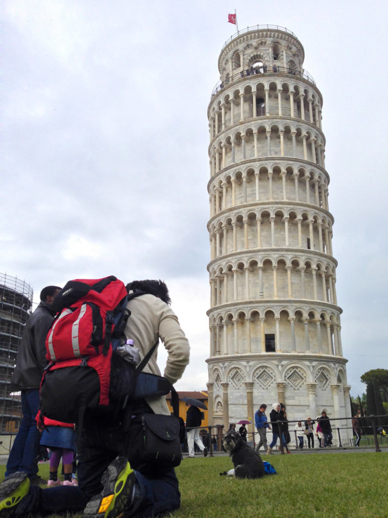 Willie having his photo taken at the Leaning Tower of Pisa in Italy