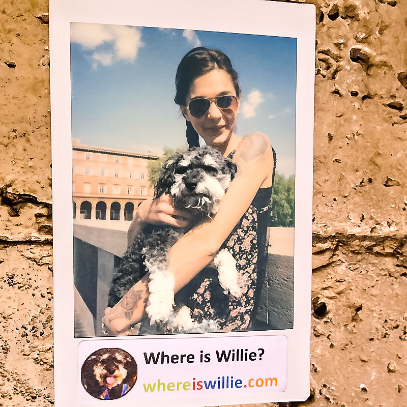 Willie gives a polaroid to his new friend Julia in Rome Italy