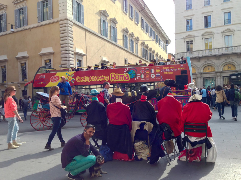 Willie hangs out in Rome Italy while a tour bus drives by