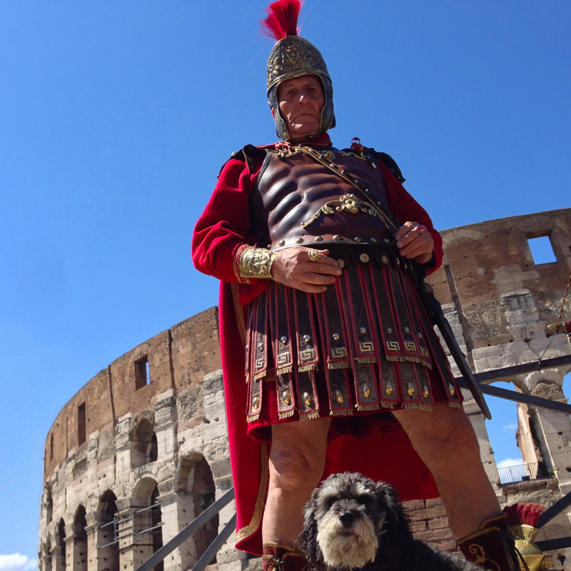 Willie poses with a guard outside The Colosseum in Rome Italy