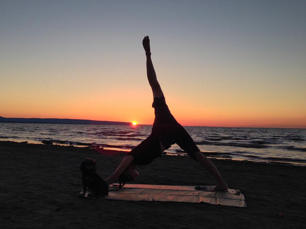 Victoria enjoying some yoga on Wasaga Beach at sunset