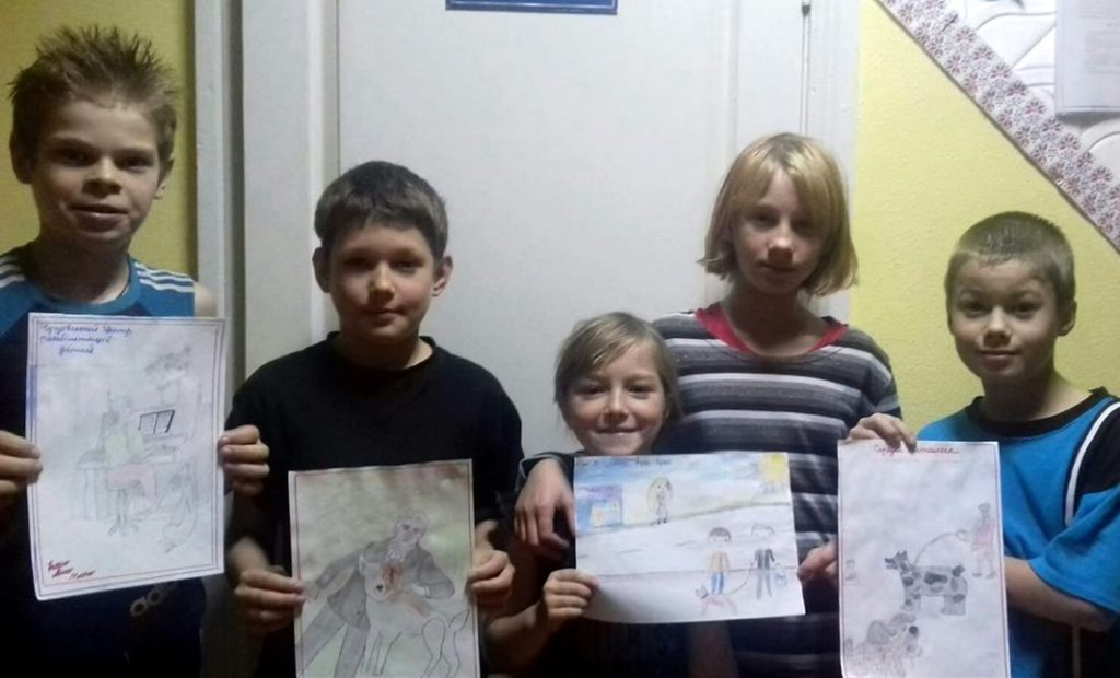 orphans from kharkiv draw photos of willie the magic dog