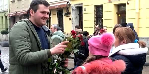 volunteer dmitry hands out flowers on womens day in lviv ukraine