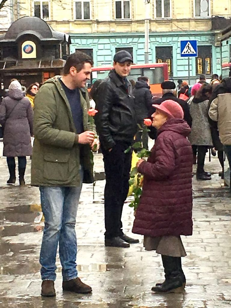 Dmitry helps Willie give out flowers on Women's Day in Lviv Ukraine
