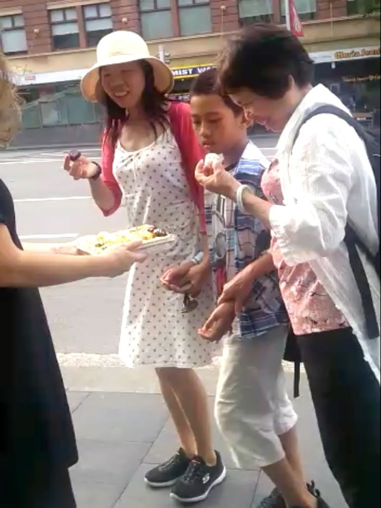 Sandra helps Willie give out chocolates in Sydney Australia