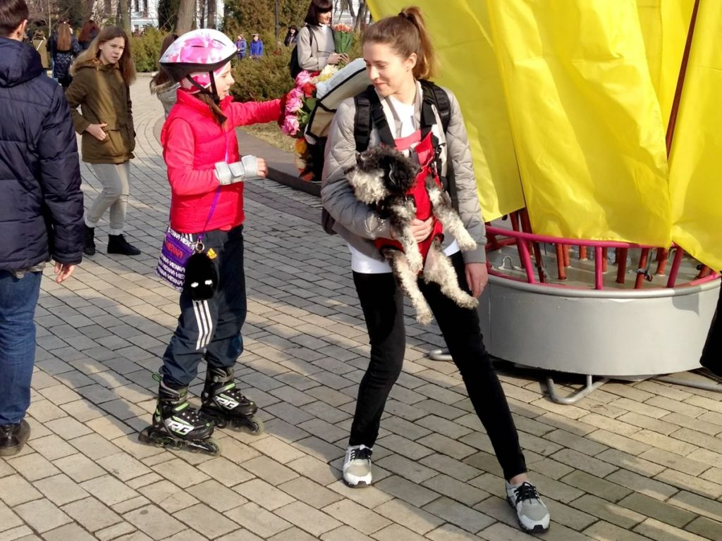 Mariya helps Willie hand out flowers on Women's Day in Kiev Ukraine