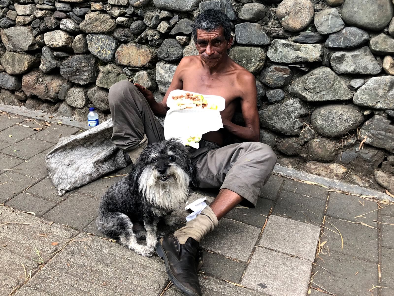 Willie provides a homeless man with a meal in Medellin Colombia
