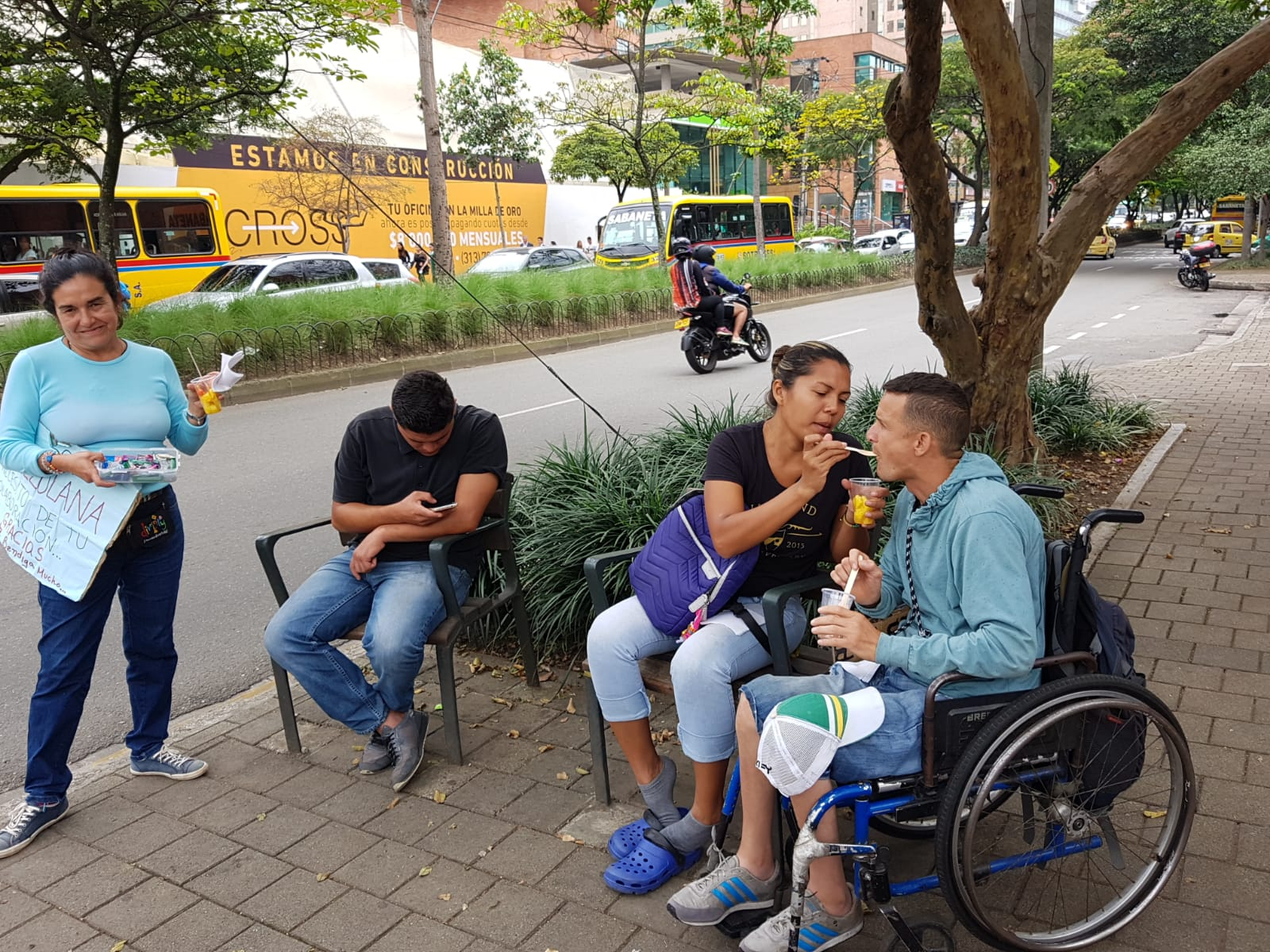 Willie gives a Venezuelan family fresh fruit in Medellin Colombia