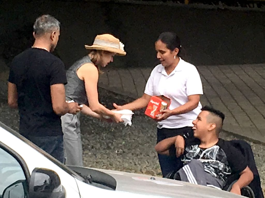 Willie's volunteers John and Dasha hand out meals to families on the streets of Medellin Colombia