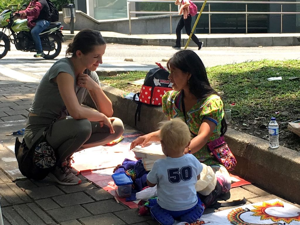 Willie's volunteer Dasha speaks with a mother about her needs in Medellin Colombia