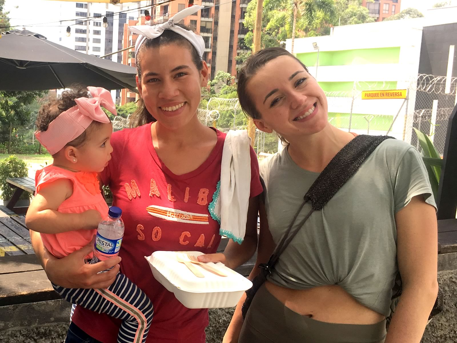 Willie's volunteer Dasha poses with a Venezuelan family in Medellin Colombia