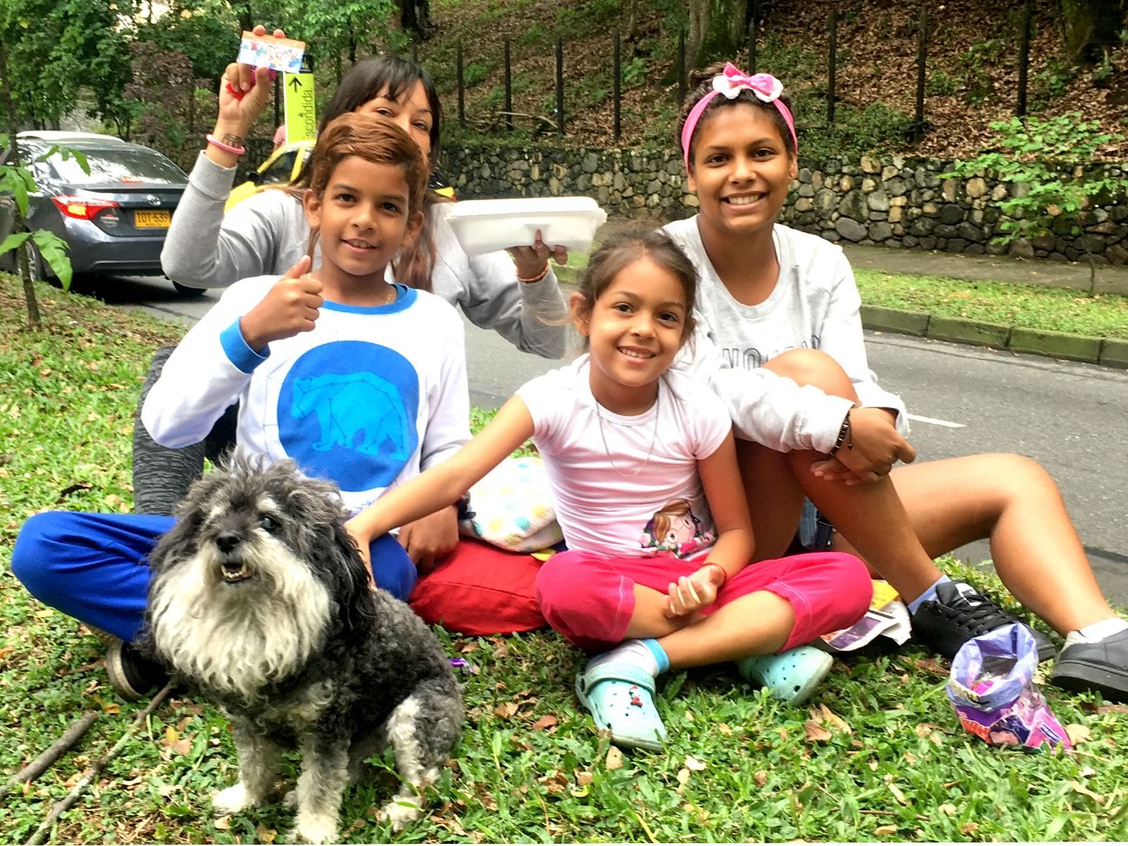 Willie poses with a Venezuelan family after providing them with a meal in Medellin Colombia