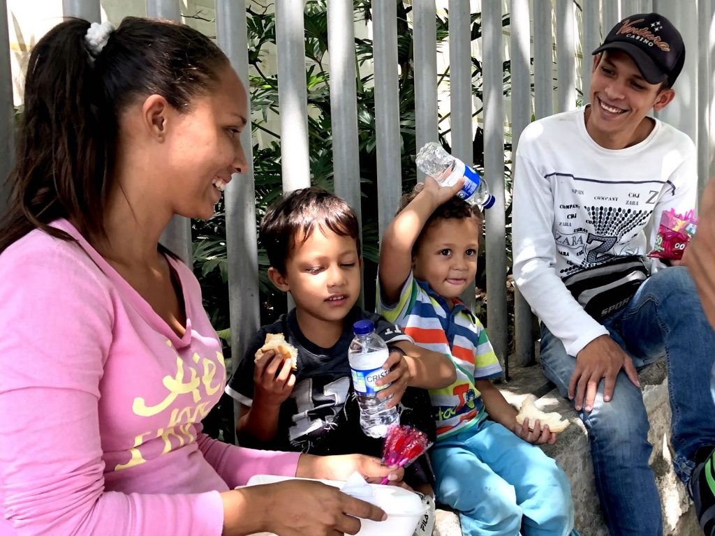 Willie gives food to a Venezuelan family in Medellin Colombia