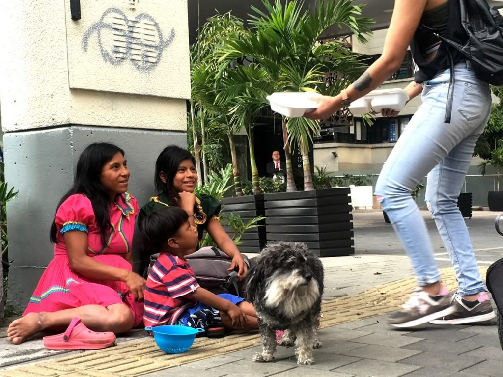 Willie's volunteers hand out meals to families on the streets of Medellin Colombia