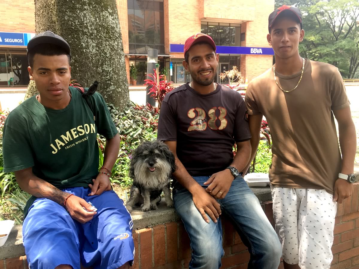 Willie with street performers from Venezuela in Medellin Colombia