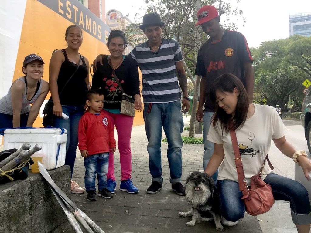 Willie poses with his new Venezuelan family in Medellin Colombia