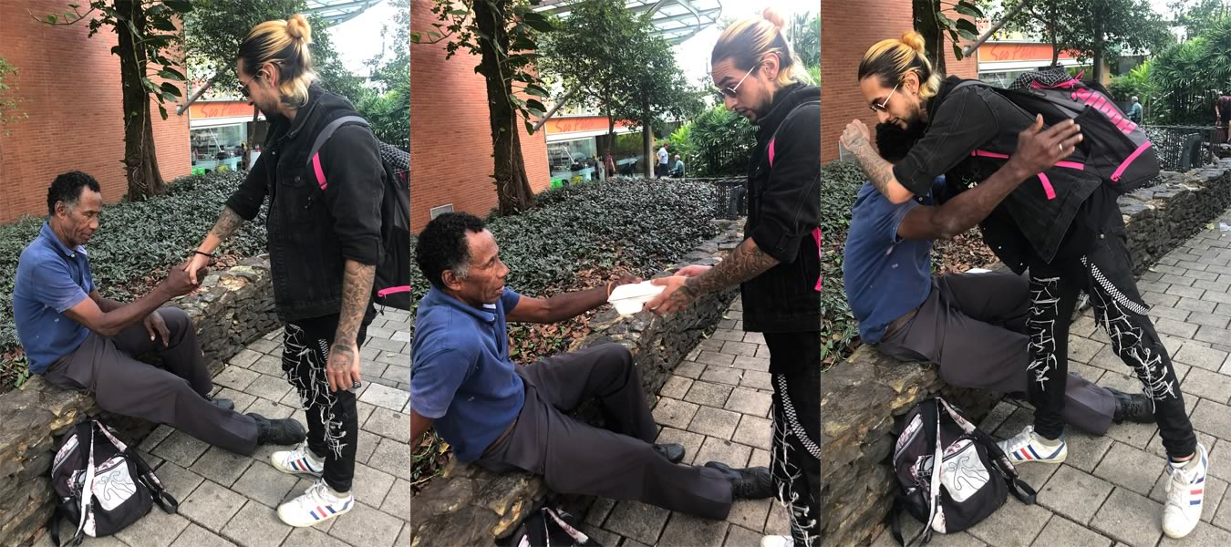 Axel makes a new friend while handing out food in Medellin Colombia