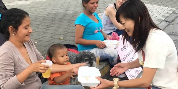 Yoriko helps hand out food to homeless and displaced Venezuelan families