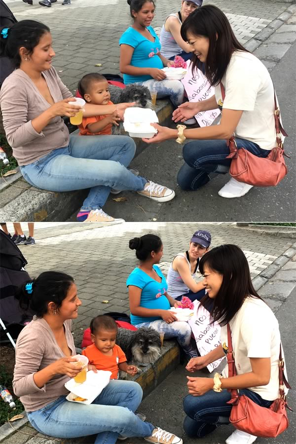 Yoriko hands out a meal to a Venezuelan family in Medellin Colombia